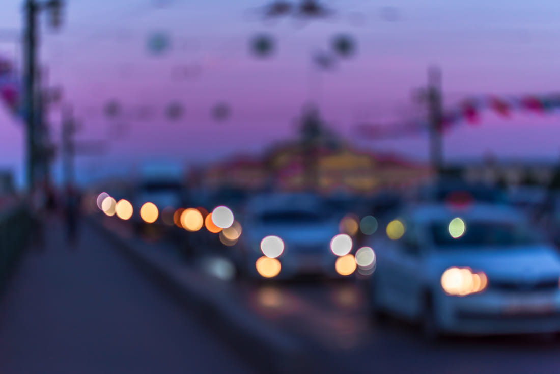 Abstract defocused image of cars driving at dusk