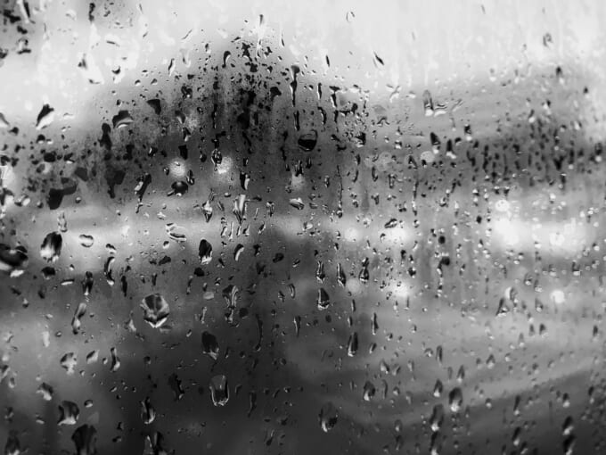 Raindrop on glass window in rainy season rain background