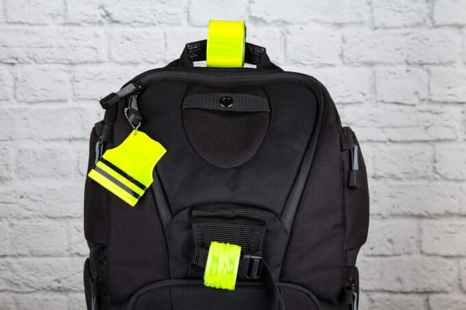 Black backpack with pedestrain safety reflectors